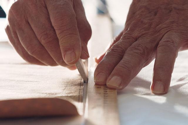 Photo of man working on fabric