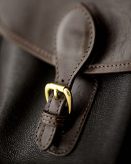 Photo of of the latch of a leather satchel