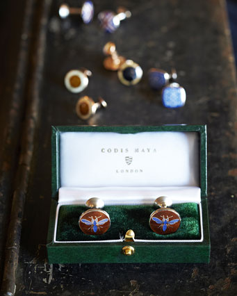 Photo of cufflinks in a box with more pictured behind