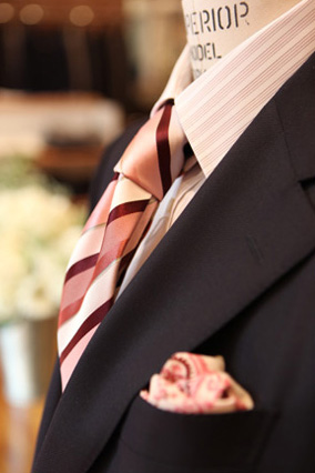 Photo of jacket, shirt, and tie on a prop.