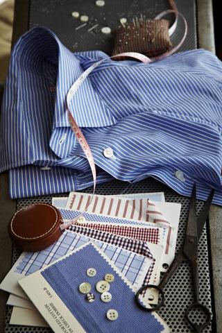 Photo of work materials, fabrics, and shirt.